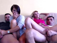 Teen amateur at party giving blowjob in group