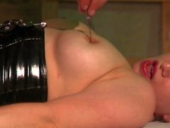 man in bondage gear uses dildos candles and chains on blonde babe
