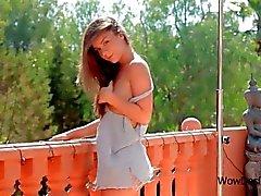 Superb teen babe stripping under an outdoor shower