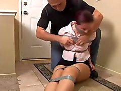 Curvy Housewife mouth packed and taped