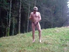 Forest stripping off walking naked