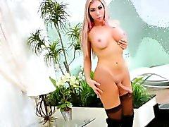 Huge booty blonde shemale masturbates her huge cock