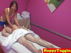 Oriental masseuse wanks cock after massage