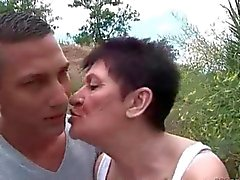 Granny fucking young guy outdoor