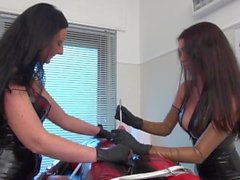 Mistress Susi and Lady Luciana milk a slave in the white room