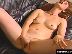 This horny redhead has really sensitive nipples. She sits on