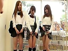 Three adorable Asian schoolgirls work their sweet lips on a