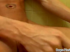 Hot young guy pisses his pants and jacks off his thick dick