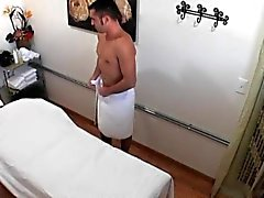 Asian masseuse riding and tugging her client