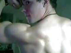 Good looking muscular gay dude shows off his strong body