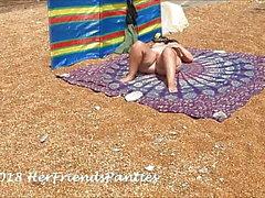 Wife and voyeurs at nudist beach