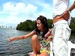 Tiny girl on a boat sucks big dick