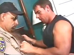 Hairy smoking cop is sucked by bear