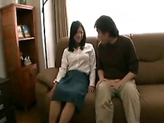 Attractive Asian mom has a younger guy fulfilling her sexua