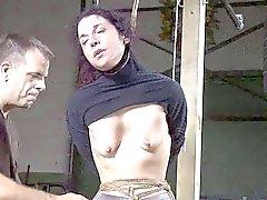 brunette woman in bondage slave