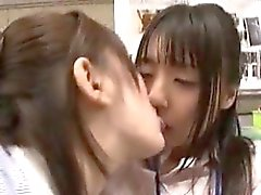 Two striking Asian babes share tender kisses and make each