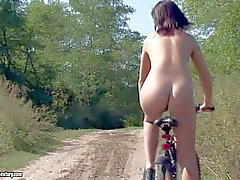 Hadjara rides the bicycle naked