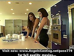 Lesbian brunette girls cooking and flashing tits