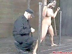 Busty bdsm restrained sub in dungeon