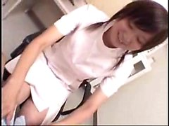Pigtailed Japanese cutie sucking and stroking a raging dick