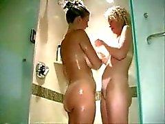 Two blonde MILF in a swinger club