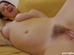 Girl With Pigtails Plays With Her Bushy And Lovely Bawdy Cleft