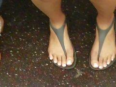 Candid 4 pairs of ebony feet on the train