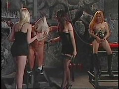 Three shemales dominate a bound guy