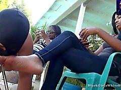 At Black Woman Feet