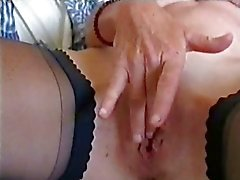 My kinky mom rubbing her big pussy. Stolen video