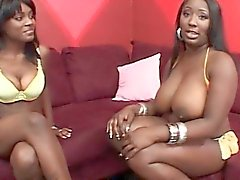 Lesbo ebony flaunting huge boobs and big ass