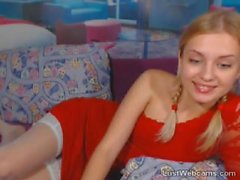 Hot blonde with pigtails masturbates on cam