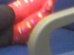 Candid ebony feet in socks on train