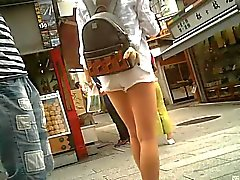 Candid white shorts and beautiful leg
