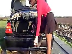 Sizzling slut inserts large thing near her vehicle