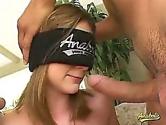 Kelsey blindfold and with two cocks in her mouth
