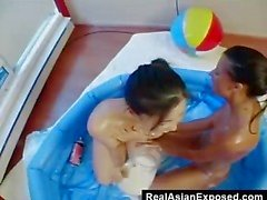 messy teen lesbians having fun in empty pool