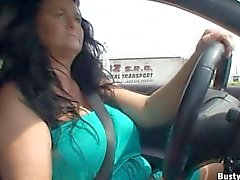 Busty Reny topless driving