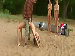 3 girls trained naked on the beach