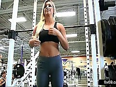 Beautiful blonde teasing her tits at the gym workout video