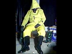 Wanking in yellow rubber.