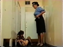 A classic woman is dominated by dark tranny policeman