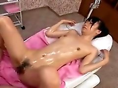Sexy slender Japanese babe with a perky ass gets massaged a