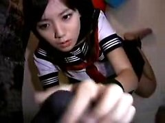 Asian teen in a sailor suit gets fingered and blows before
