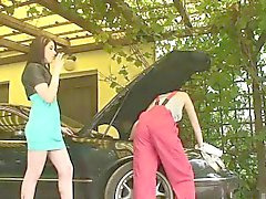 Adrianne steps out to the carport to tempt sexy lesbian galp