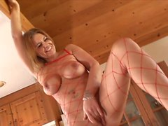 Naked chick in fishnet body stocking has her toes sucked