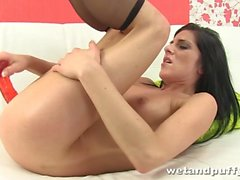 Dark haired babe fills her pussy