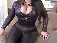 Big tits Samantha leather catsuite facesitting