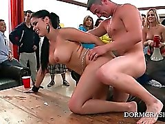 Big titted pornstar working two dicks at college sex party