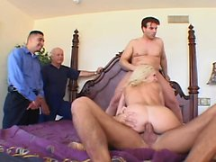 Irresistible blonde wife takes on three hard sticks at once on the bed